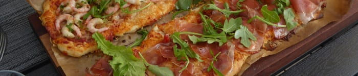 Avlånga pizzor med lyxig fyllning